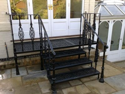 Cast metal balcony and riven York stone paving, designed ...