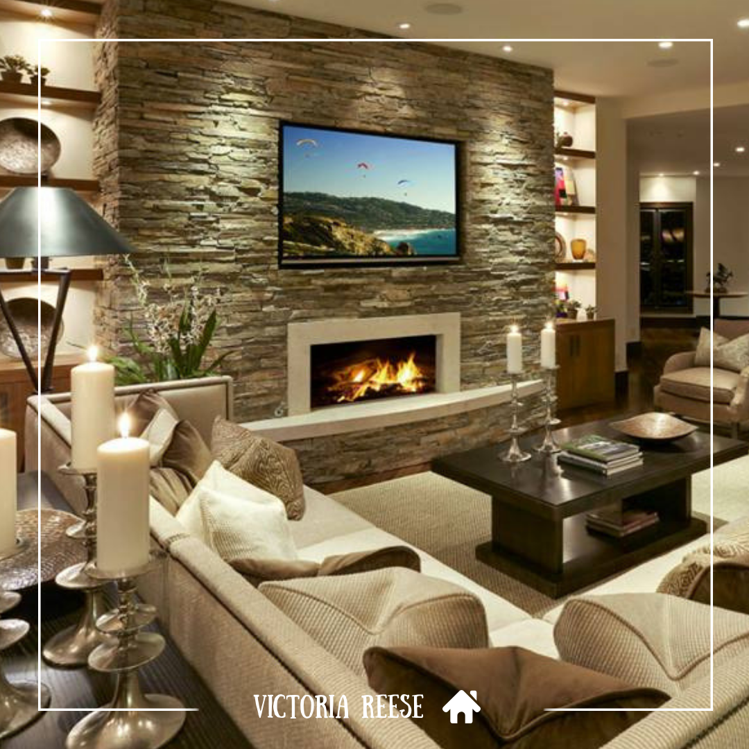 The Stone Accent Wall Creates A Strong Focal Point In This Living Room Space Whether You Re Modern Family Rooms Modern Family Room Design Elegant Living Room