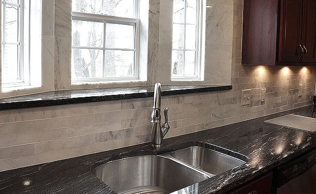 Black Granite And Dark Cabinets Lighten Up Kitchen With White Light Backsplash