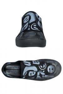Black and white #leather printed pull on #shoe with elastic and fastens with Velcro.