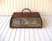 maps in a wooden case