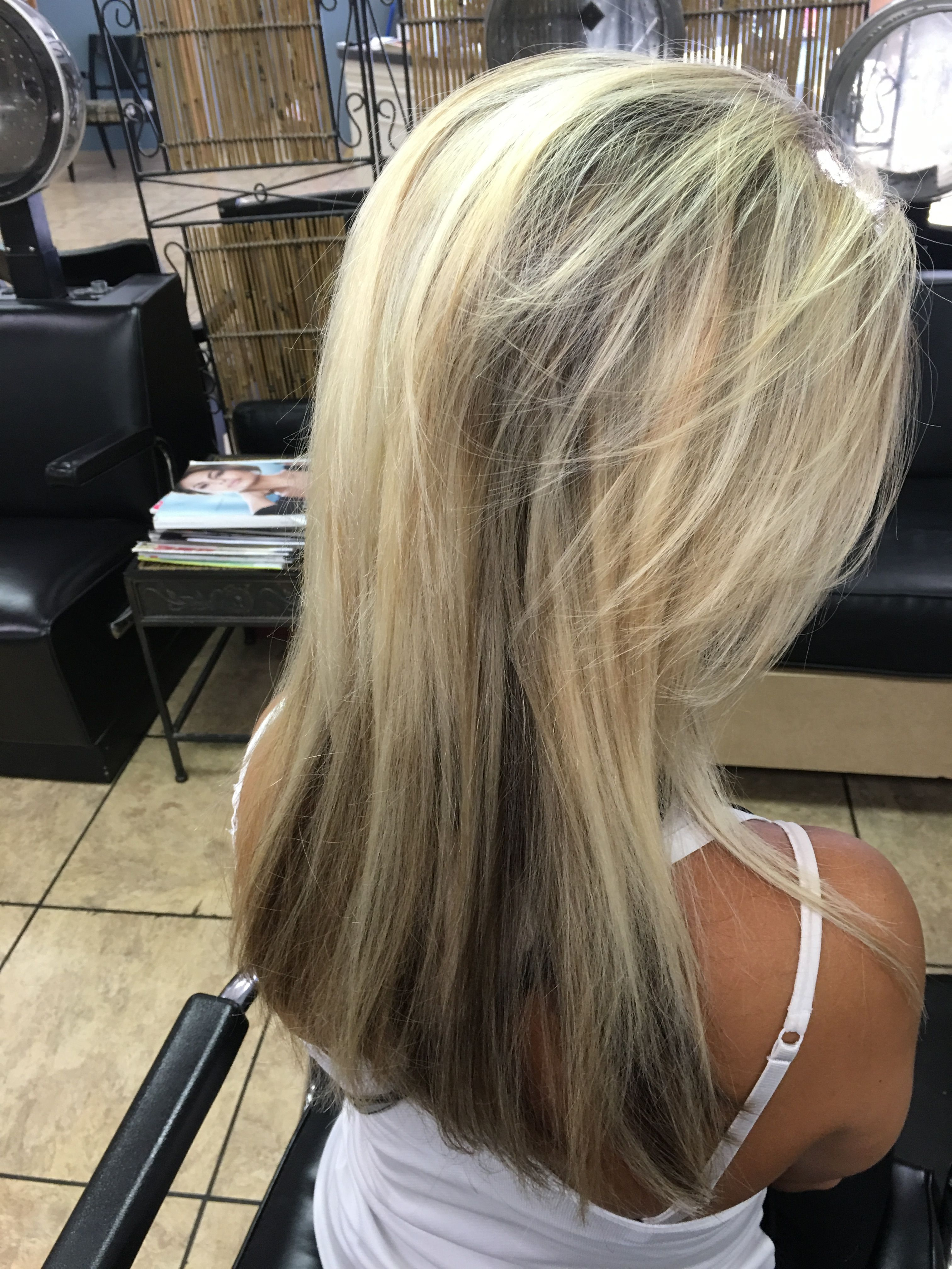 Highlights With Dark Brown Ash Underneath And Medium Length Layers
