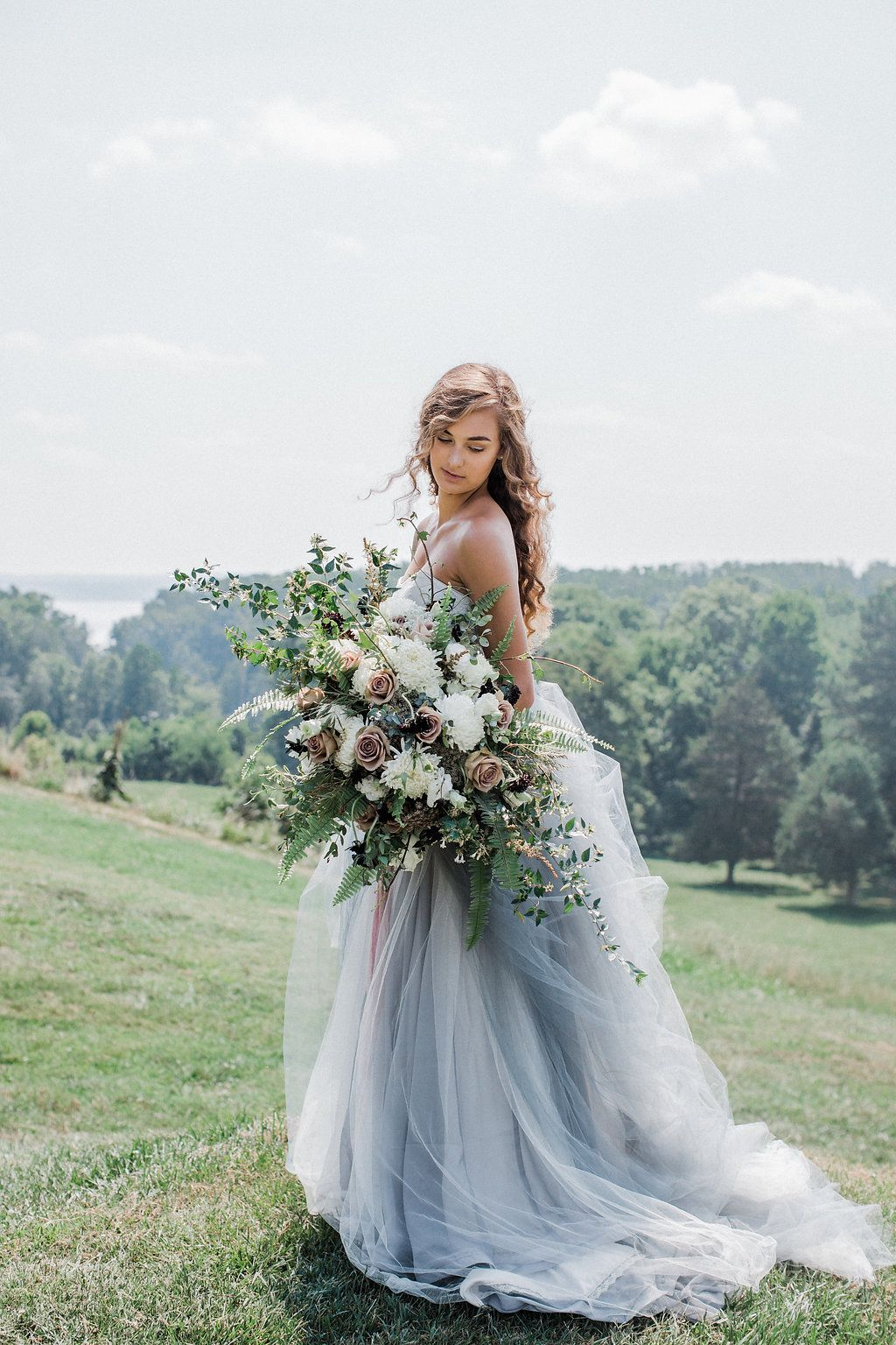 Beautiful oversized bridal bouquet and an exquisite gray wedding