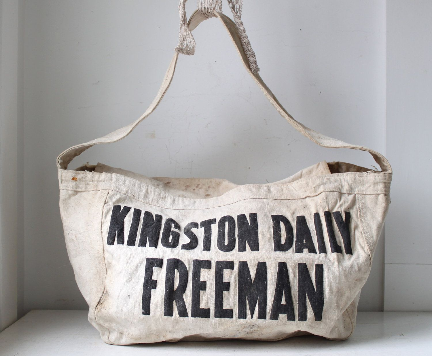 vintage 1950s newspaper bag. Kingston Daily Freeman delivery bag. Black on white canvas. Shoulder bag / hobo / messenger / book bag. $58.00, via Etsy.