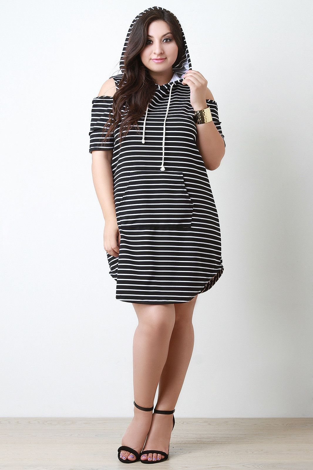 Open Shoulders Hooded Pocket Striped Dress – ZillyChic This plus size dress is shift dress silhouette; featuring a drawstring hood, short sleeves with cold shoulders, and a pocket at front. Stripe print throughout. Textured knit. 95% Polyester. 5% Spandex. Made in USA.