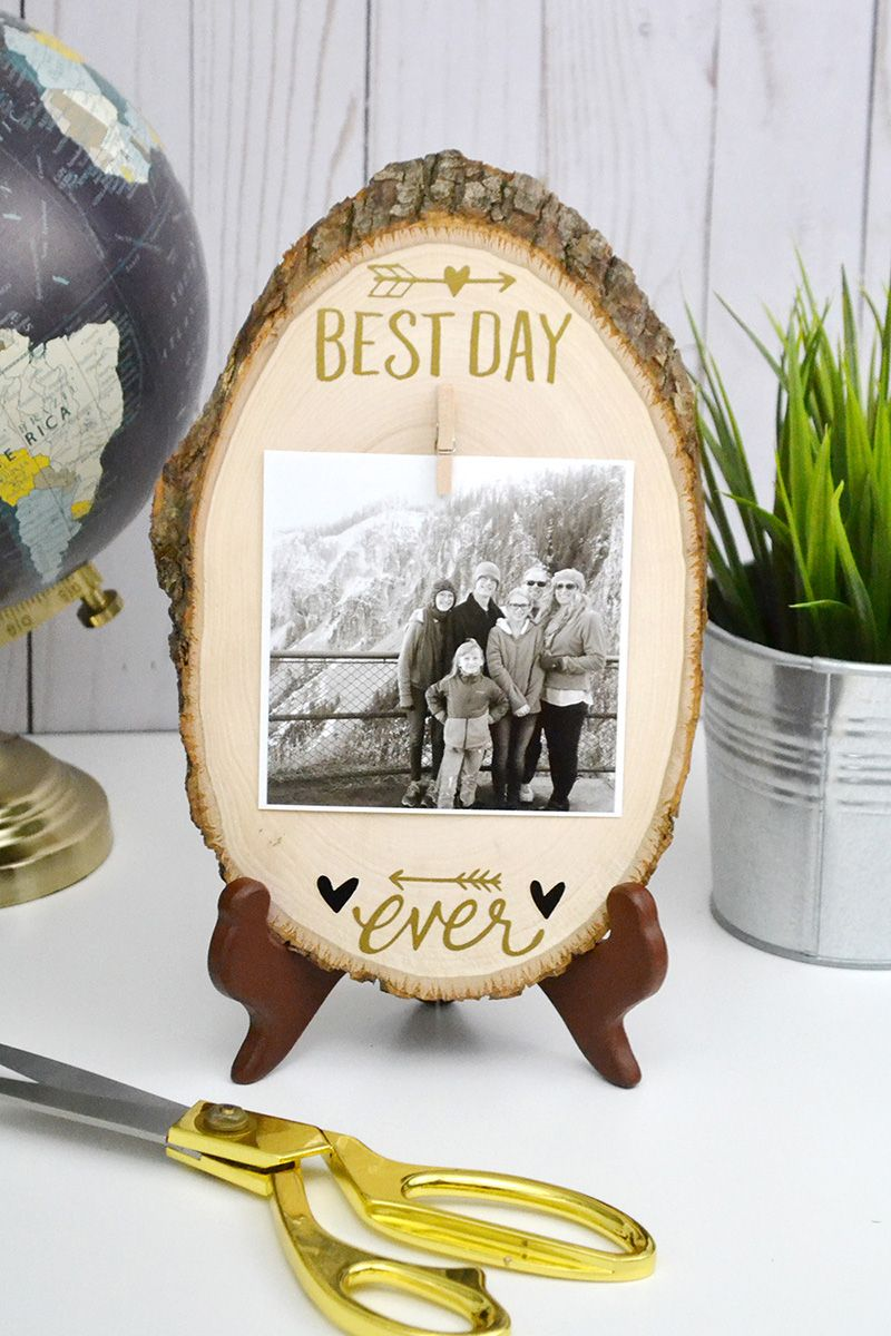 Create an easy and beautiful photo display with a wood slice and rub-ons.