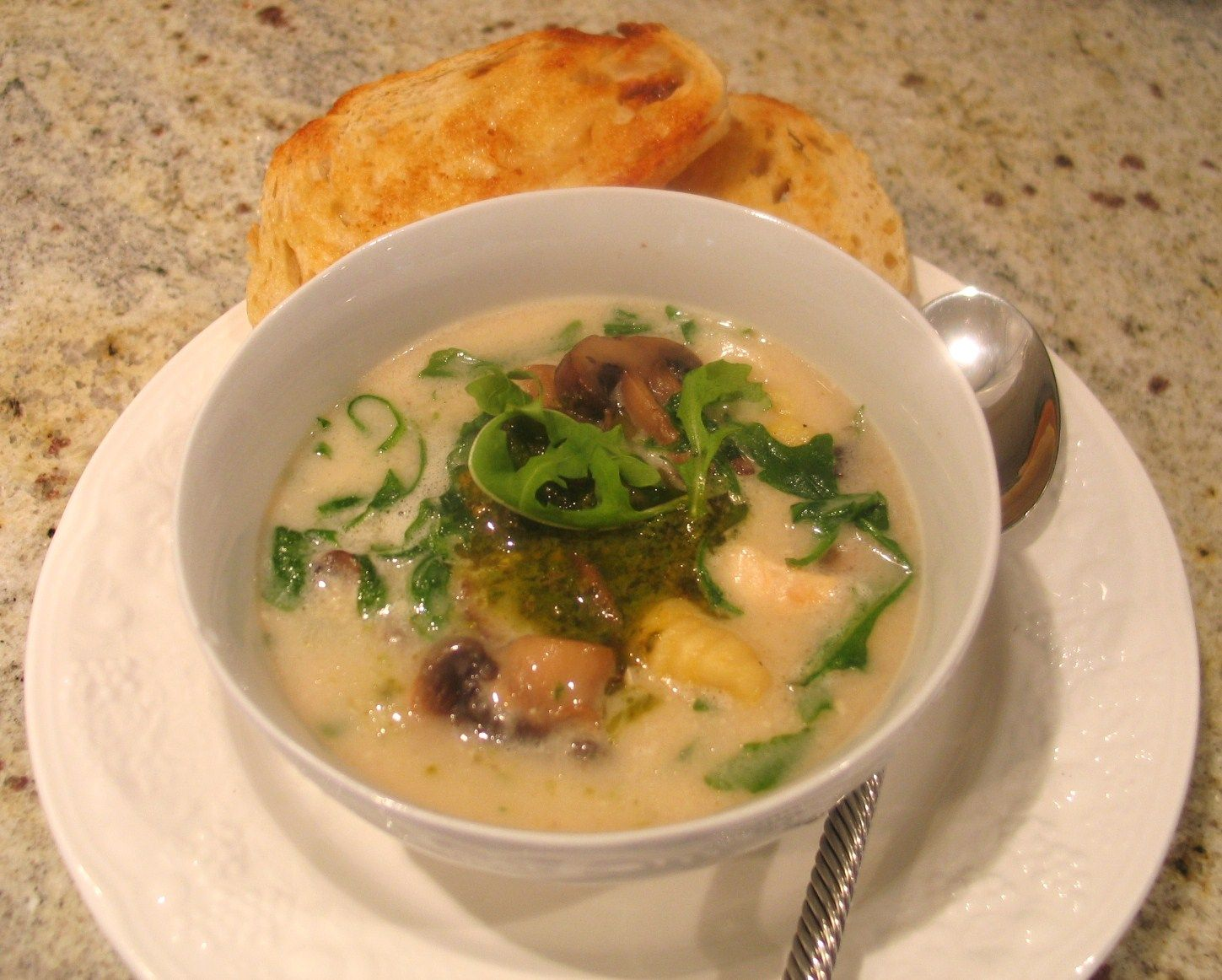Creamy Chicken and Mushroom soup with Arugula and Gnocchi topped with a bit of Pesto