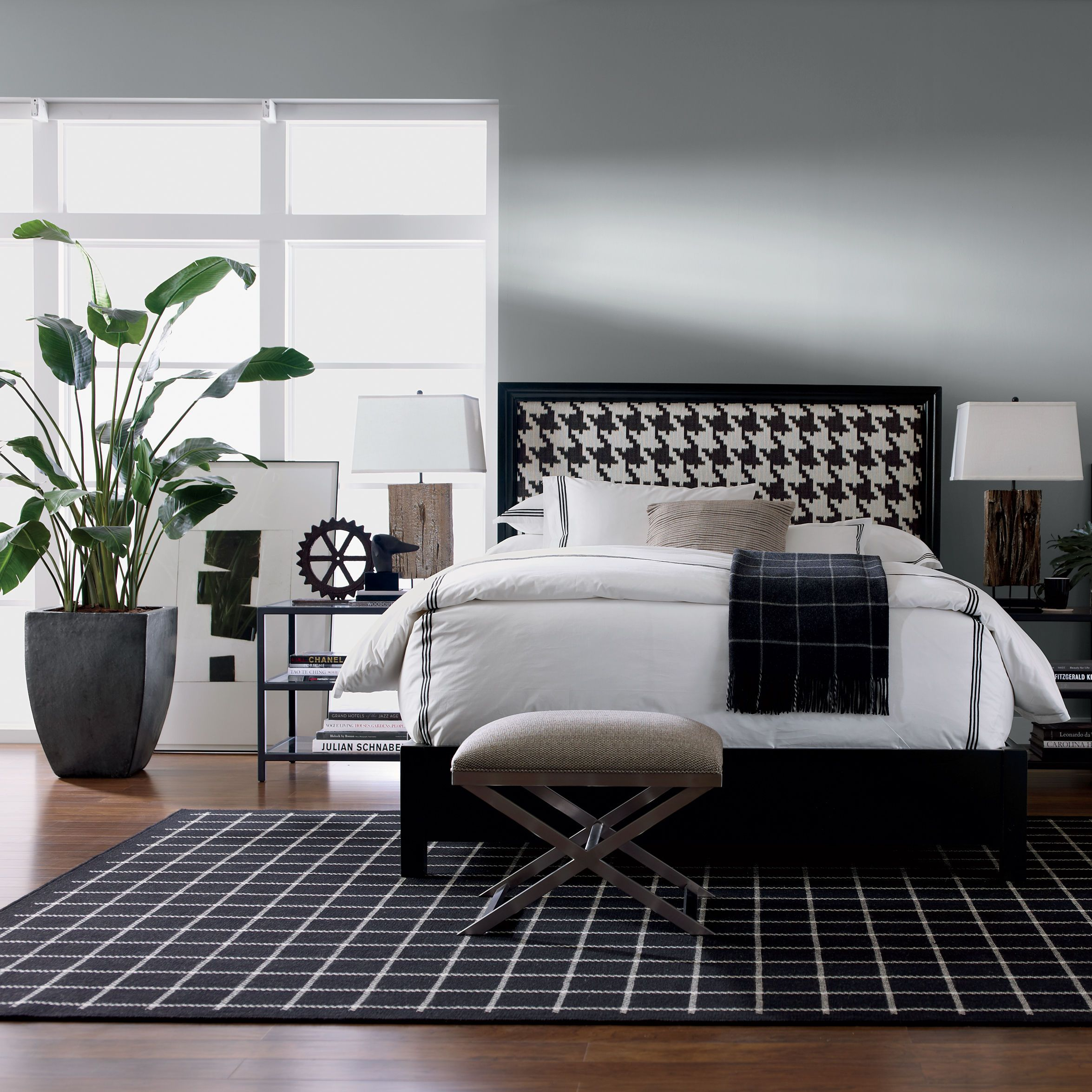The Clic Menswear Print Takes Center Stage In This Black And White Bedroom