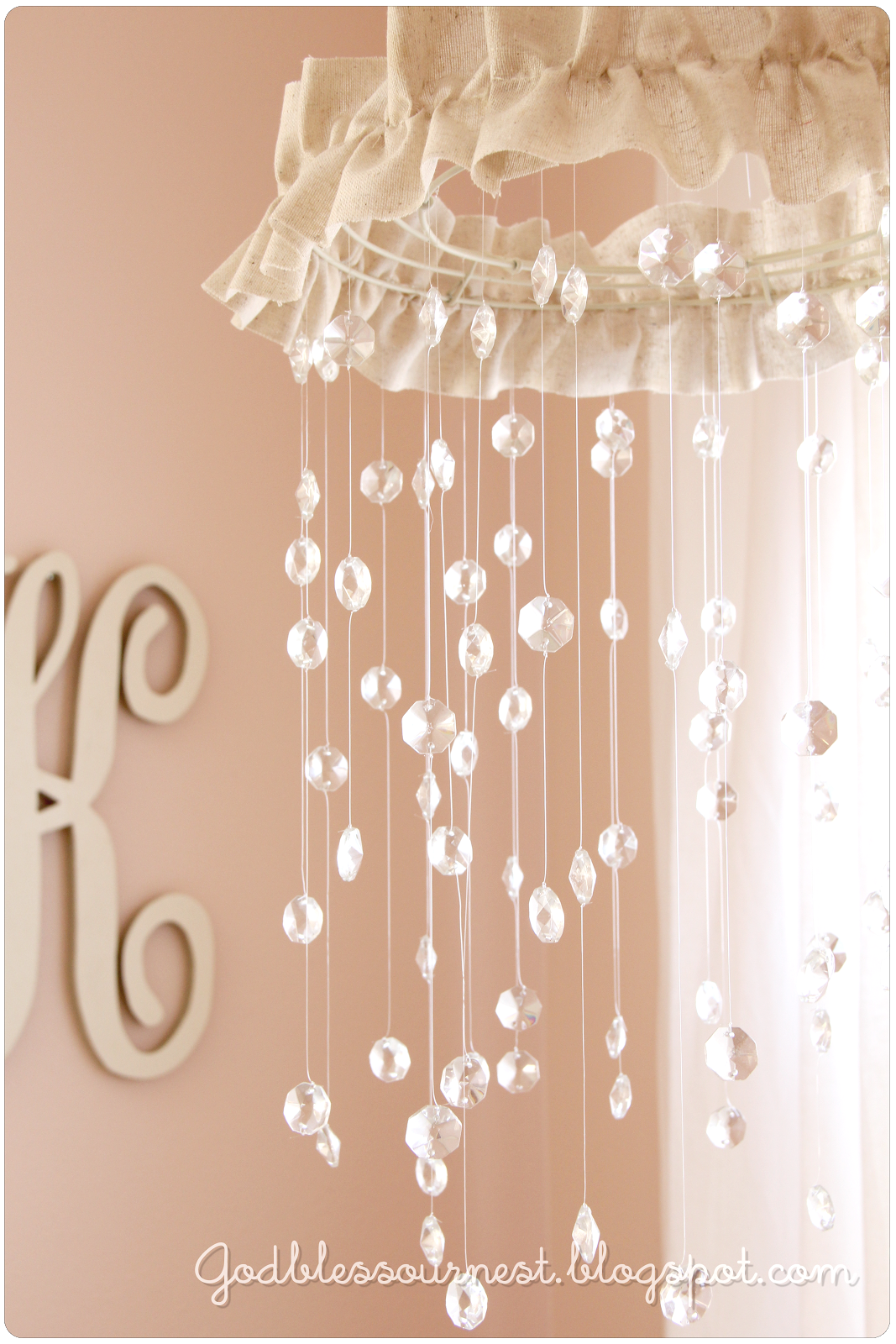 Diy crystal baby mobile wire wreath form heavy fishing line 100 diy crystal baby mobile tutorial spray painted wire wreath frame chandelier crystals fishing line fabric or other trim to hide wreath frame arubaitofo Gallery