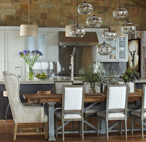 Staggered Glass Pendant Lighting Gives Whimsical Ambiance To This Dining Room The Rustic Farm Table And Natural Accents Make A Grand Open Concept