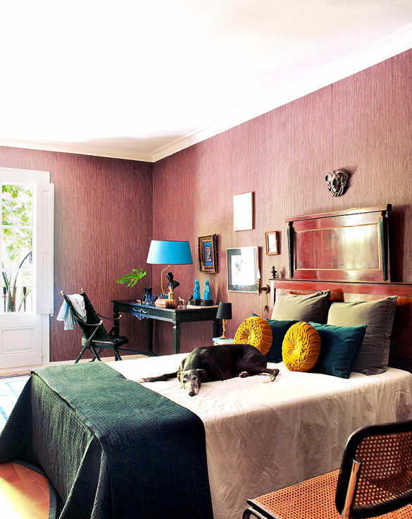 Masculine bedroom with grasscloth wallcovering and salon style art arrangment