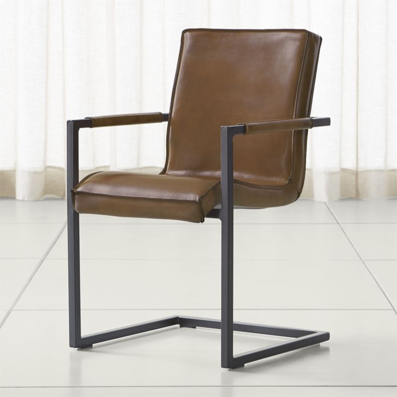 Shop Hudson Brown Leather Dining Chair. A cantilevered black