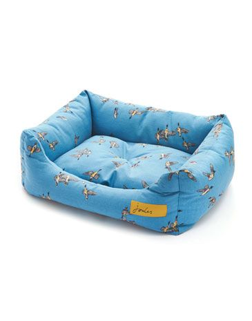 #joules #christmas #wishlist Joules null Snugglebed Pet Bed, Dora Ducks Blue.                     The Snuggle Bed is a rectangular shaped bed featuring deep filled fibre shoulders for enhanced comfort with drop down front for easy access. The complete bed is fully machine washable and the base cushion is removable, perfect for quick washes.