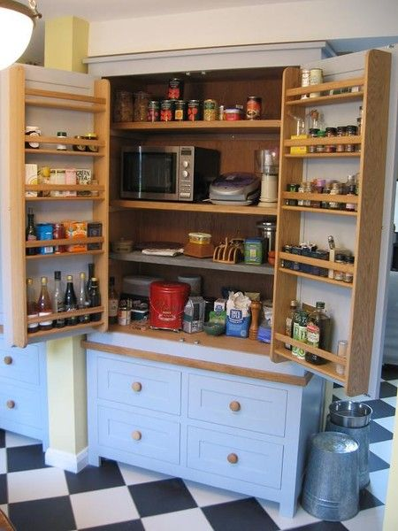 English larder kitchen cupboard- also notice the upside down galvi cans for dog food bowl risers- genius!  Would make great kitchenette for the lower level