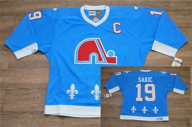 low priced 6ccf4 c9990 quebec nordiques 19 joe sakic light blue throwback ccm jersey