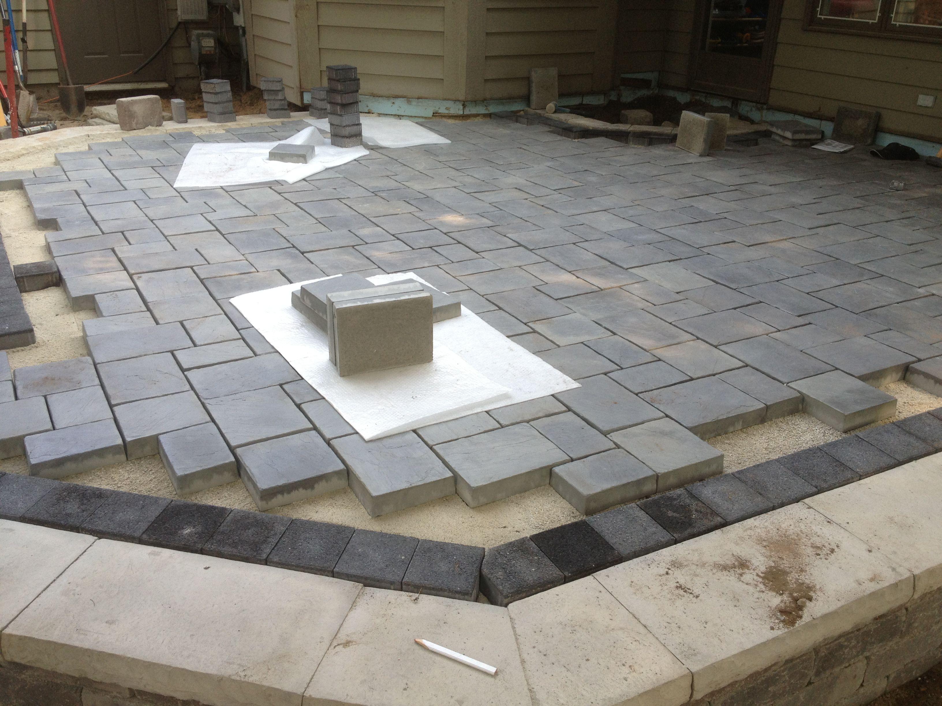 Work in progress patio using Unilock brick pavers. Stonehenge coping,  Series 3000 black accent