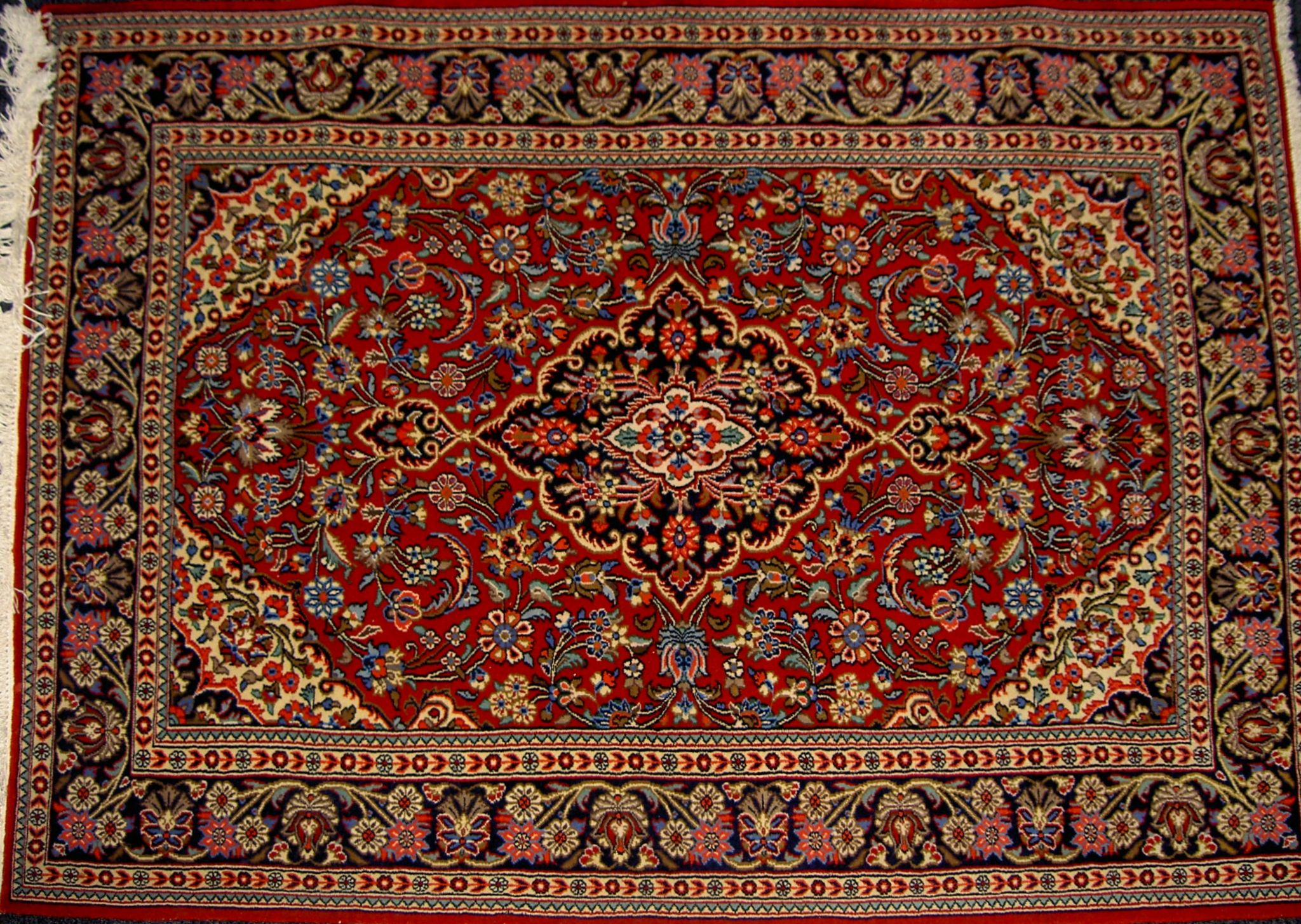 Rug from Qom, Iran. Design Lachak and Toranj