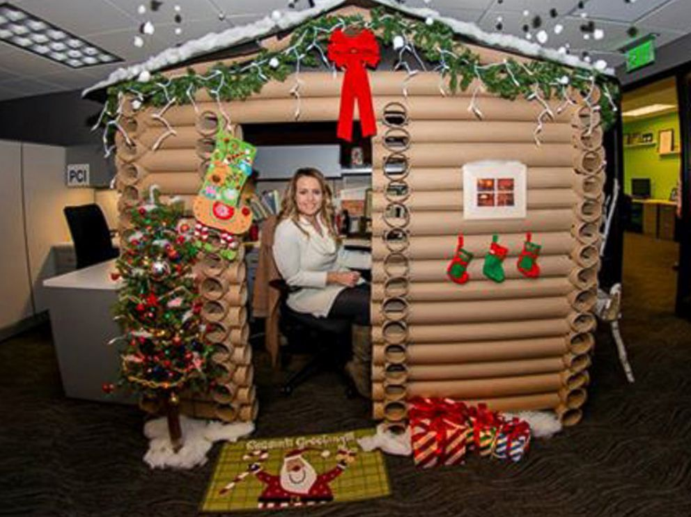 Woman wins christmas with log cabin cubicle cubicle log for Cubicle decoration xmas