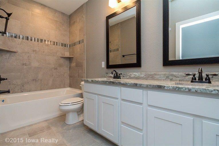Transitional Full Bathroom with Drop-In Bathtub, Flat panel cabinets, Rain Shower Head, limestone tile floors, High ceiling