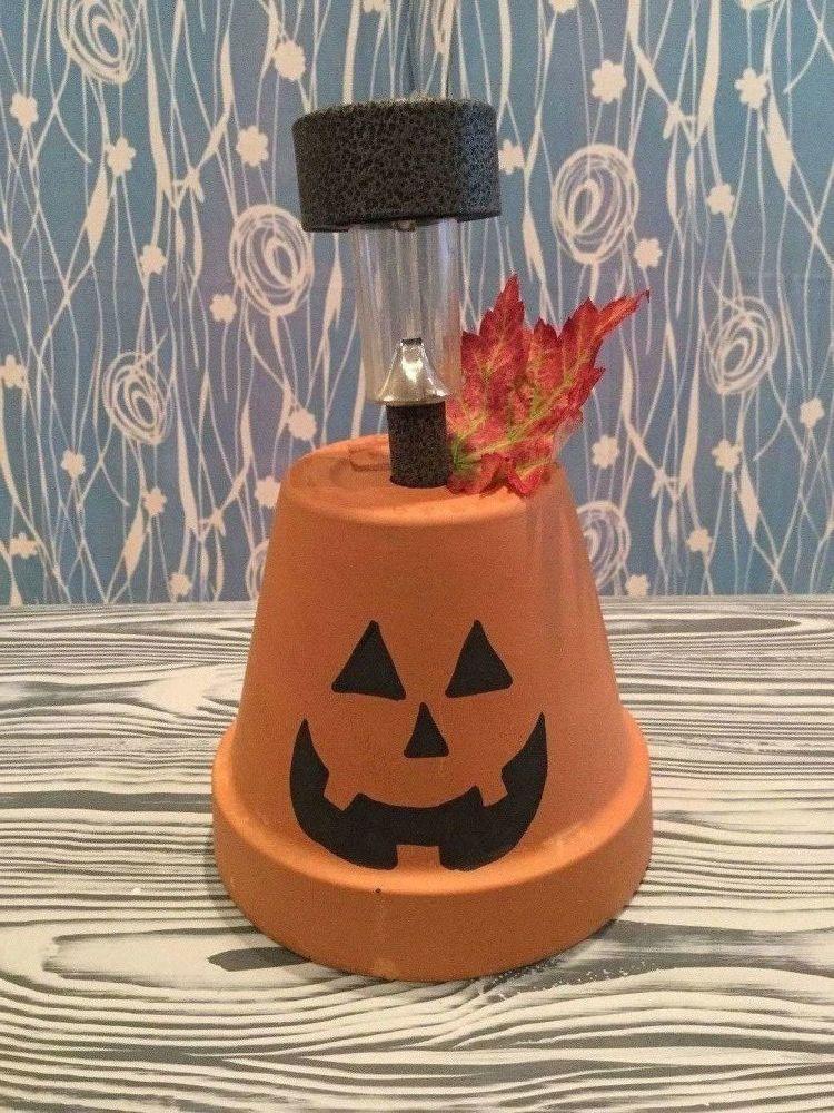 Flower Pot To Solar Pumpkin Halloween Flower Pot Crafts Solar Light Crafts Terracotta Flower Pots
