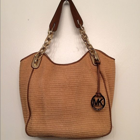 Perfect for Spring Michael Kors bag Used but in good condition . Show sign  of used inside .No tear or fading. This is a wicker type bag with brown  leather ... 772861a8cb