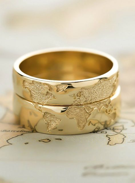 Photo of Wedding rings with world map embroidery for couples who love to travel the world …