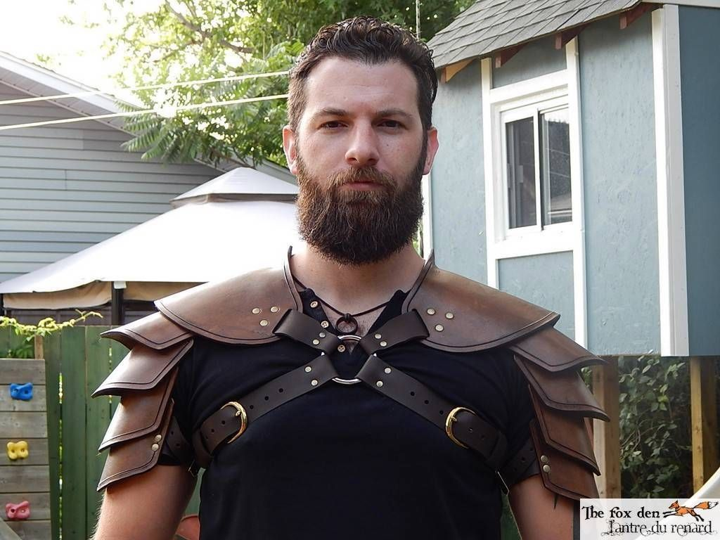 Black or brown.LARP Viking leather single shoulder armor with added side straps