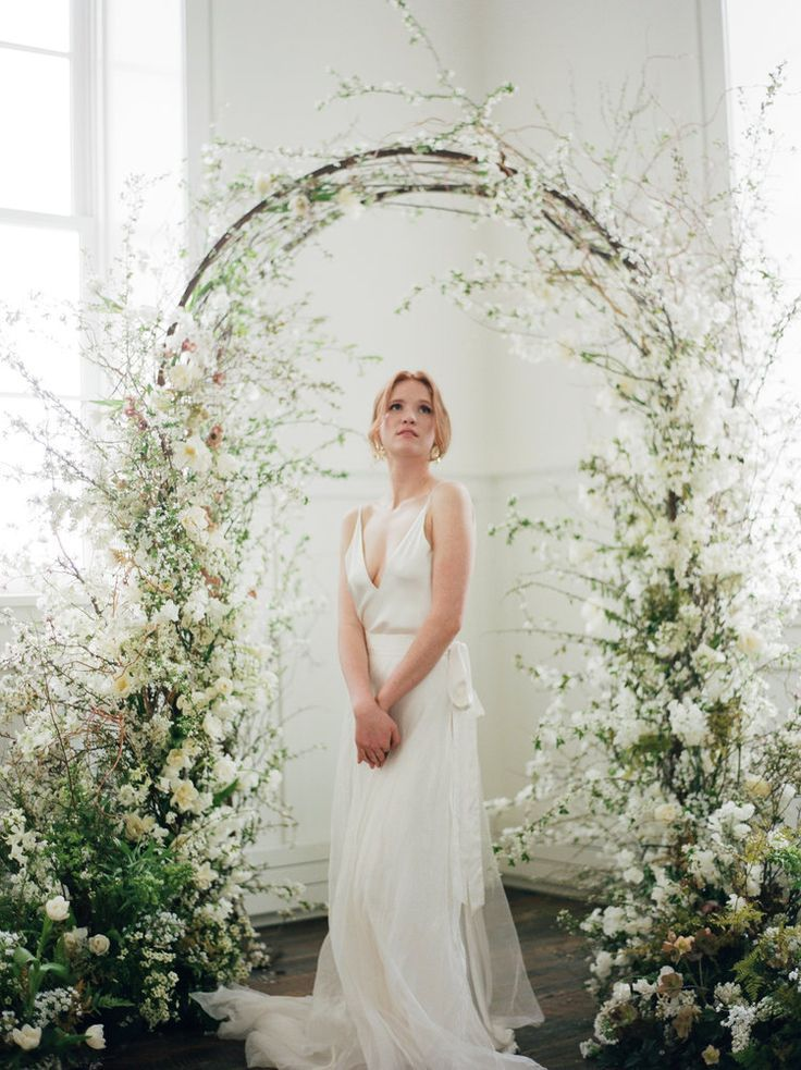 Wild floral ceremony arch, ethereal wedding inspiration