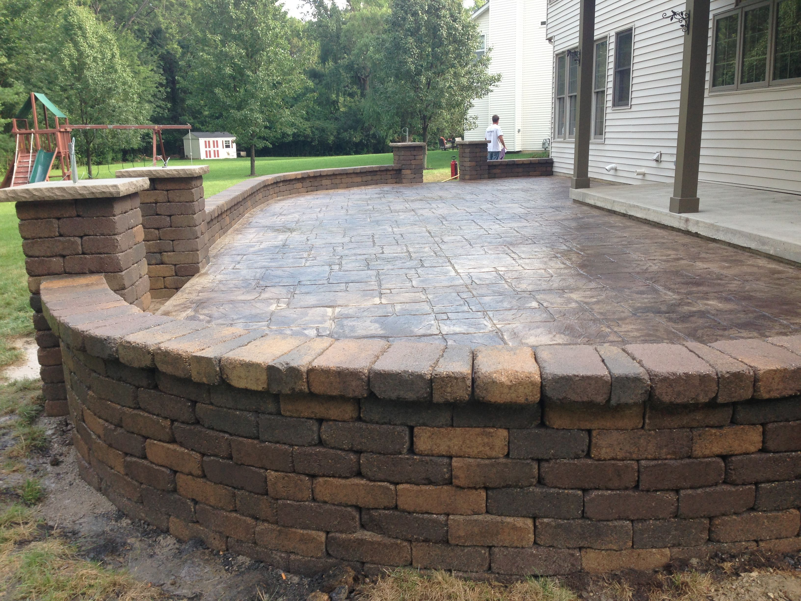 Decorative Stamped Concrete Patio With Retaining Wall And