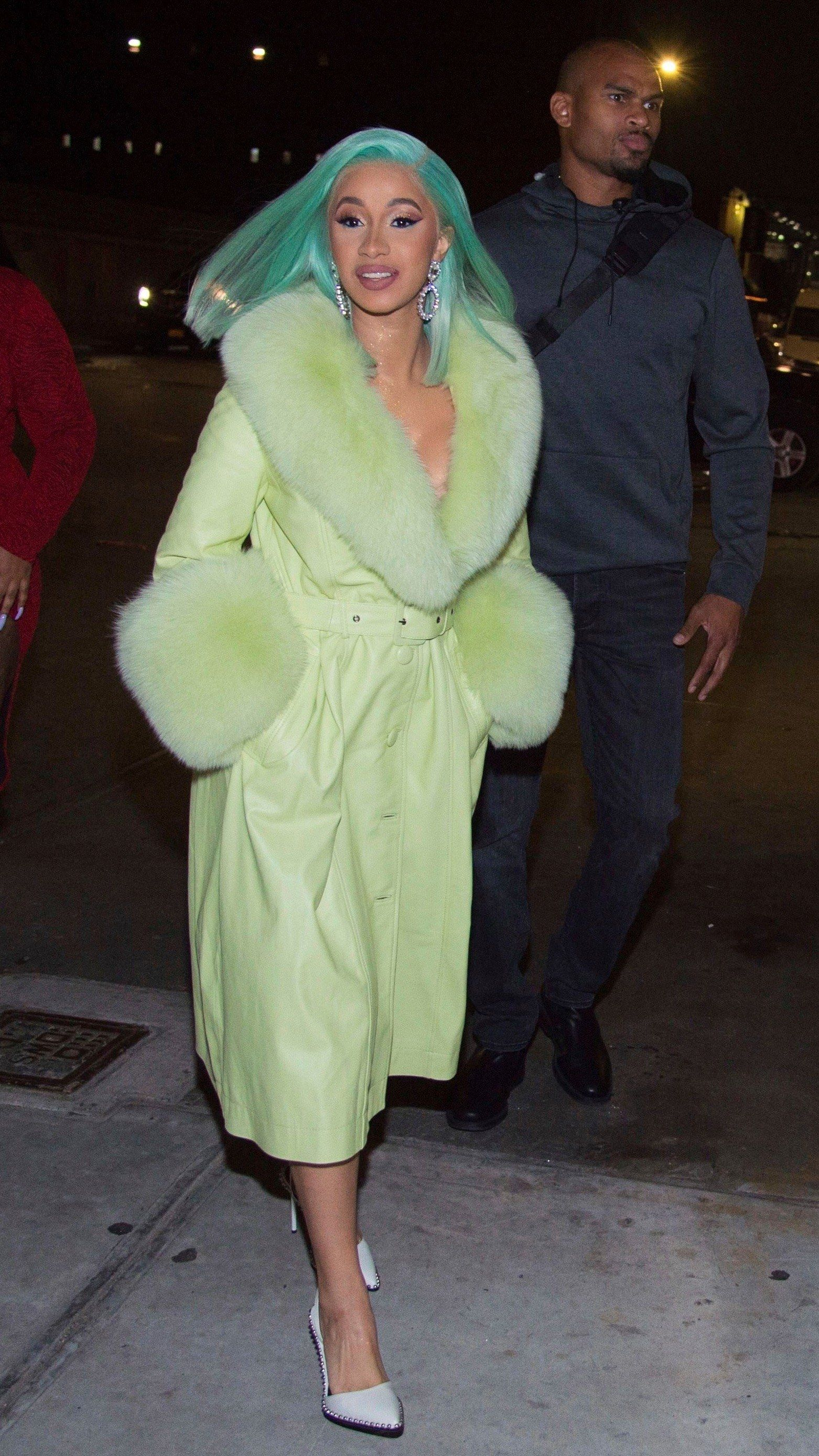 Cardi b is back from paris fashion week and wearing a limegreen