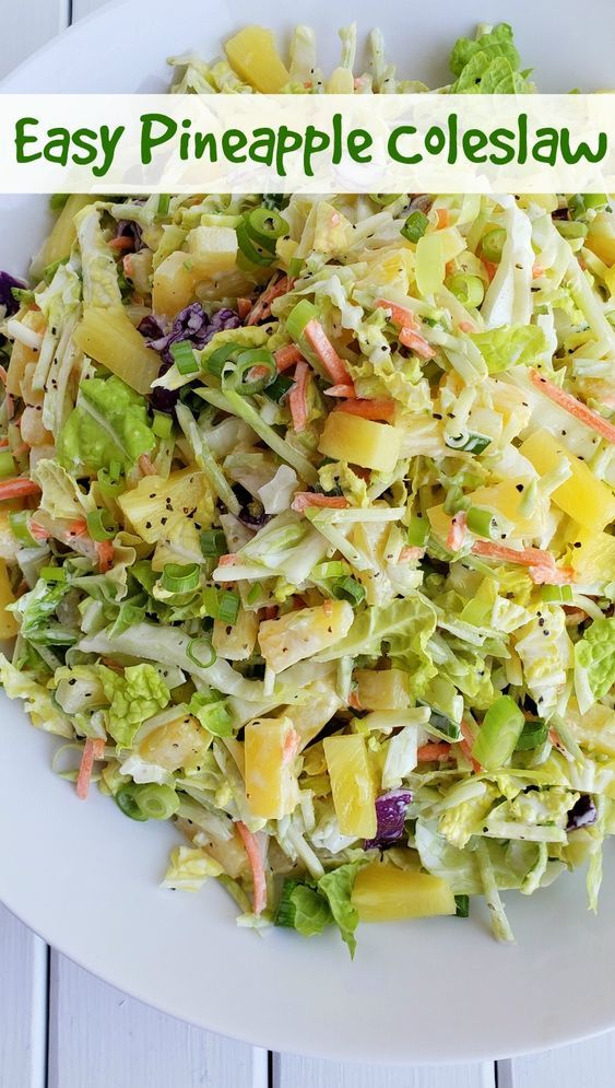 This Easy Pineapple Coleslaw is going to remind you of summer all year long. Enjoy as a side dish or top your favorite chicken burger with this one. #noblepig #coleslaw #pineapple #sidedish #chickensidedishes