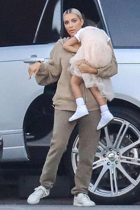 Kim Kardashian wearing Adidas Yeezy Calabasas Powerphase Sneakers