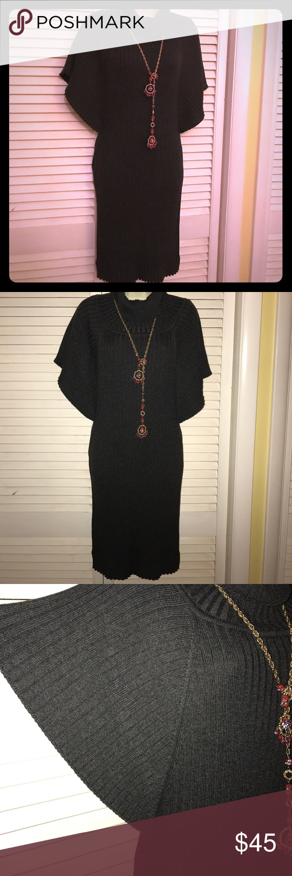 Calvin Klein Sweater Dress Gorgeous!  Ribbed Calvin Klein dress with flared cap sleeves. Perfect condition. It's a VERY dark gray/black. Calvin Klein Dresses Midi