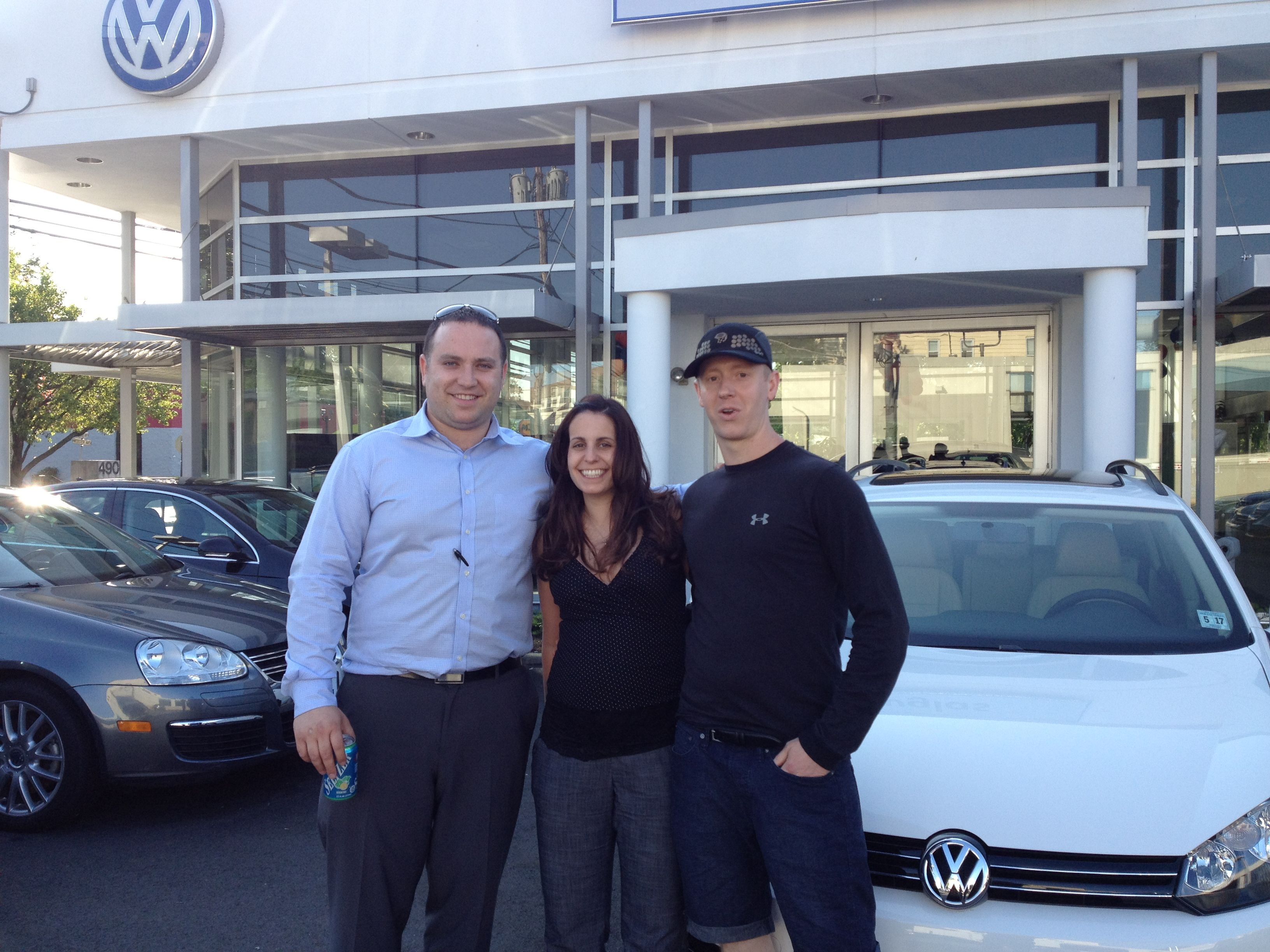 Anna And Travis Markouris Of Morristown Nj Picking Up Their 2012 Vw Sportwagen From Douglas Vw Sales Consultant Vlad Vosko Cars For Sale Volkswagen Livingston