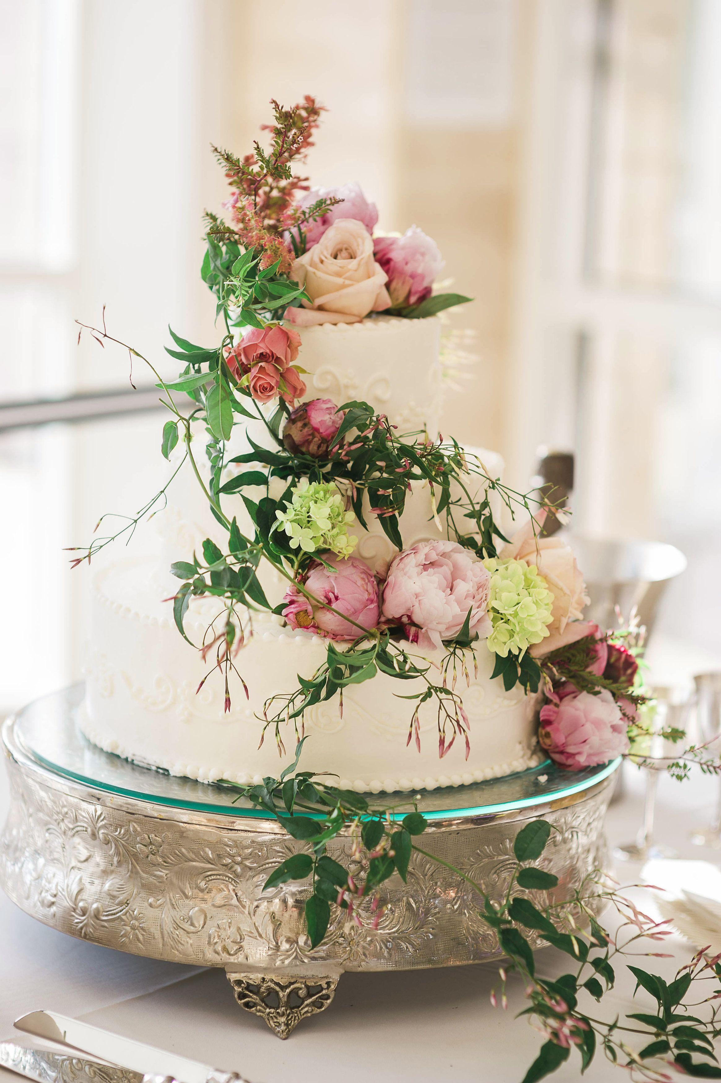 Wedding cake garden style flowers with jasmine, peonies ...