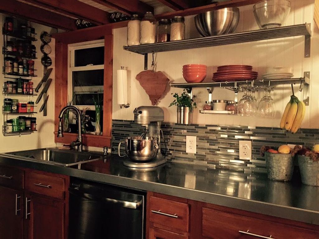 Modern tiny home boasts a big kitchen for foodies treehugger - Tiny House Big Farm Kitchen Stainless Steel Countertops Tile Backsplash Tiny