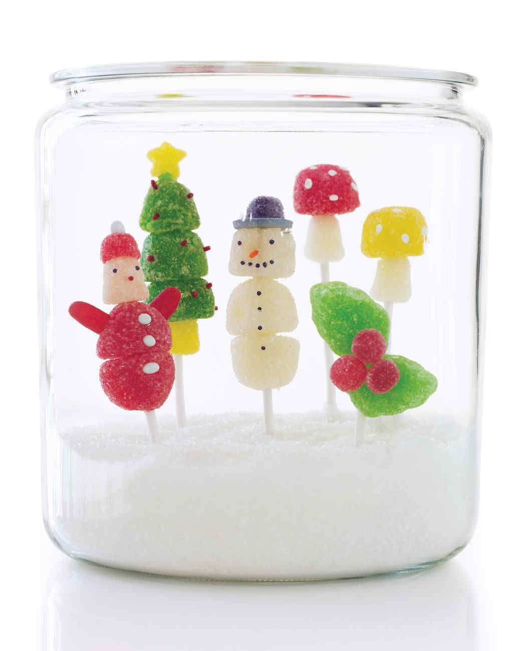 Gumdrop Pops in a Jar Homemade Christmas Gifts | Martha Stewart Living — Fill a large glass jar with sanding sugar, and place homemade figurines on flower frogs in the sparkling snow for a beautifully edible gift.