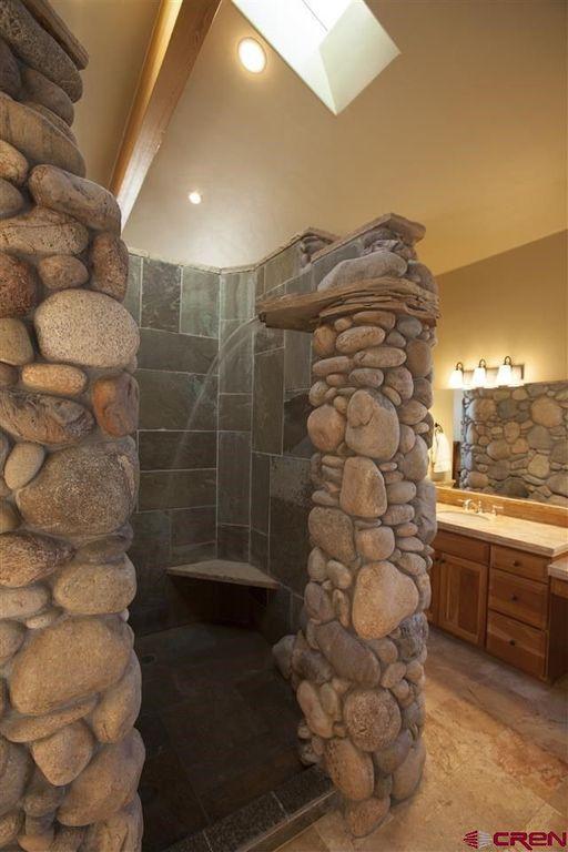 Rustic Master Bathroom With Skylight Limestone Undermount Sink Raised Panel Counters Flush