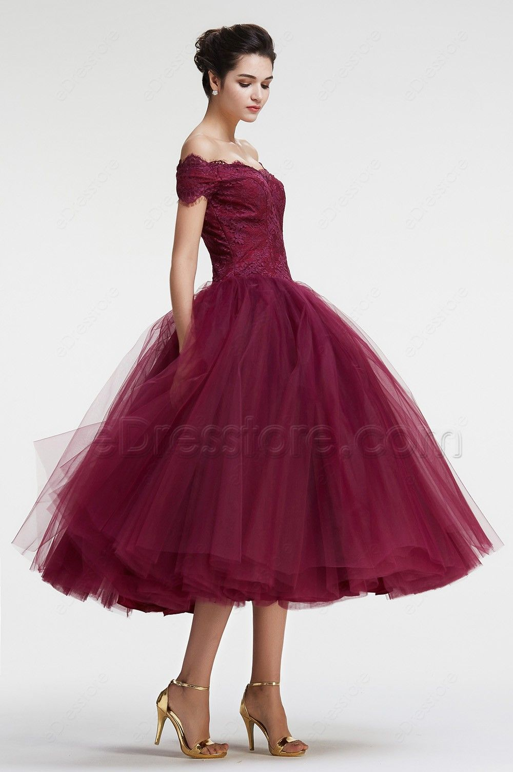 f2410a4cfa The burgundy prom dress features off the shoulder neckline with scalloped  lace