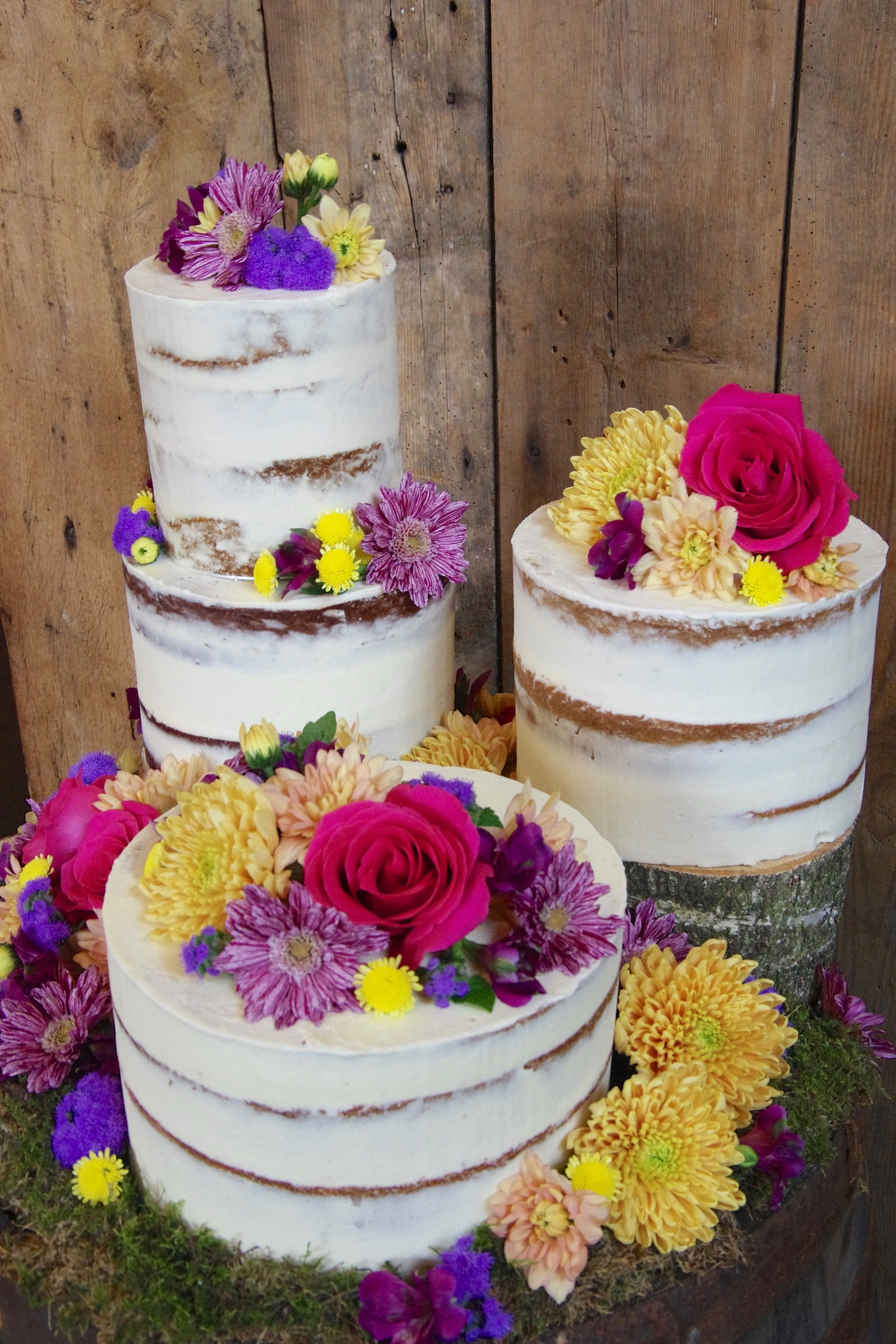 Wedding cake by Belle's Bakery. Flowers by The Flower Mill