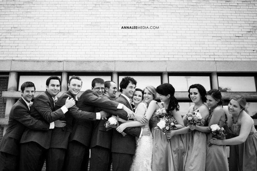 Oklahoma Wedding Photographer City Bridal Party Fun Pose Group Hug