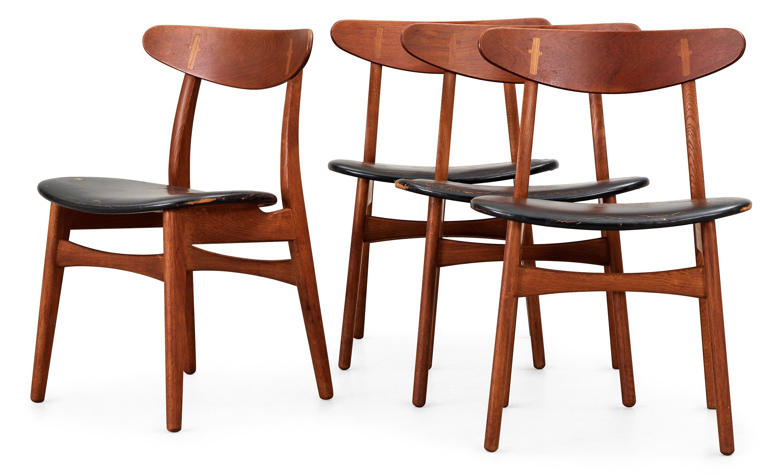 Four Hans J Wegner teak and black leather chairs Denmark Bukowskis