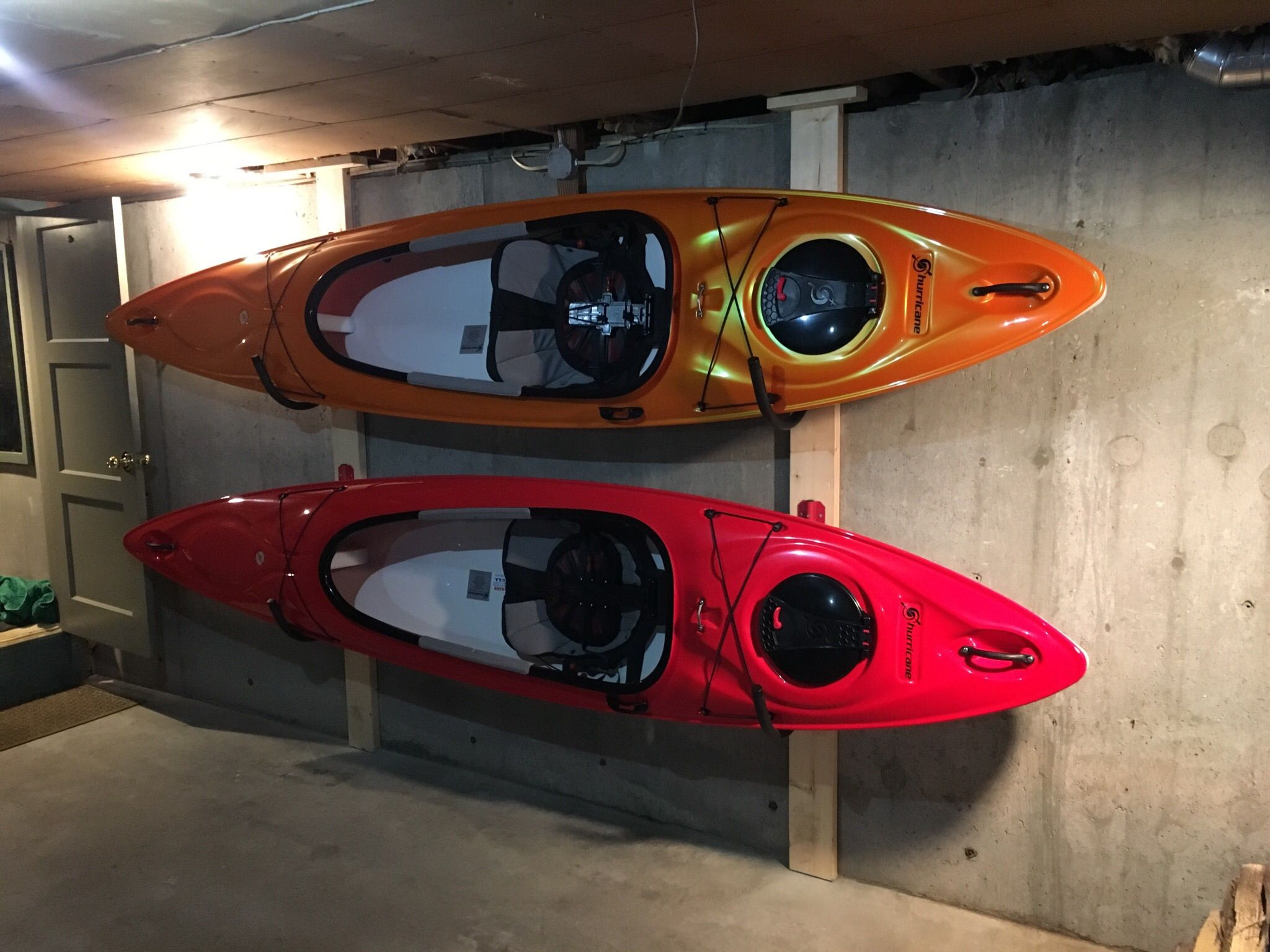 Clean Up Your Garage By Storing Your Kayaks In A Wall Rack Kayak Storage Rack Kayak Storage Kayaking