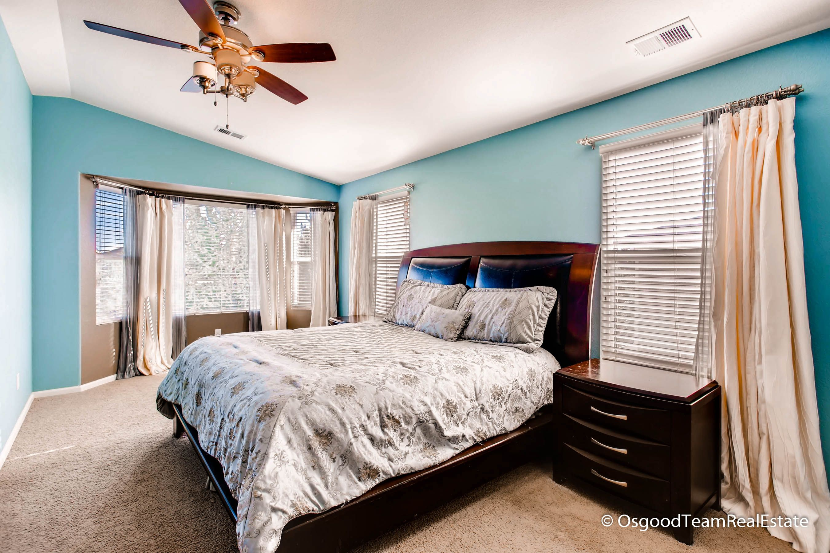 Master Bedroom With Soothing Neutral Blue Color And Tons Of