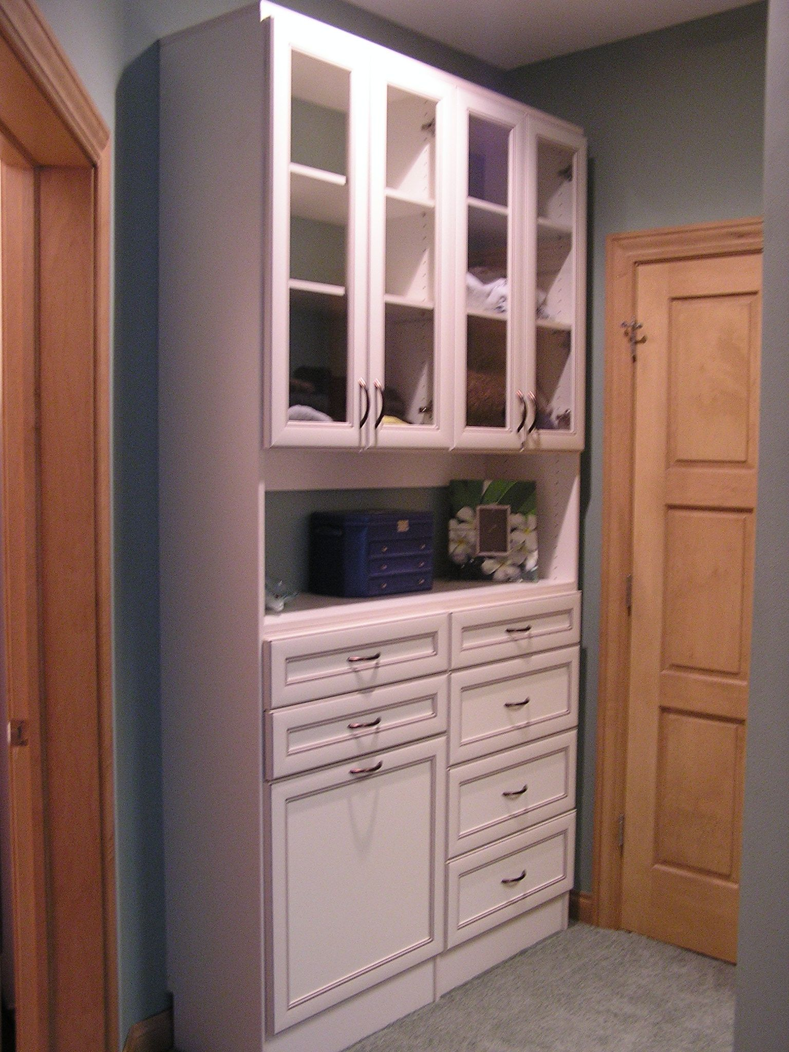 Master Closet With Hutch. The Hutch Includes Glass Doors, Laundry Hamper,  Drawers, And Space For Jewelry.