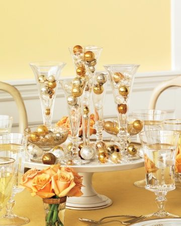 Champagne Inspired Wedding Centrepieces - Decorate your tables with Champagne-flute-inspired vases, then fill them with metallic ornaments that mimic the festive beverage's bubbles