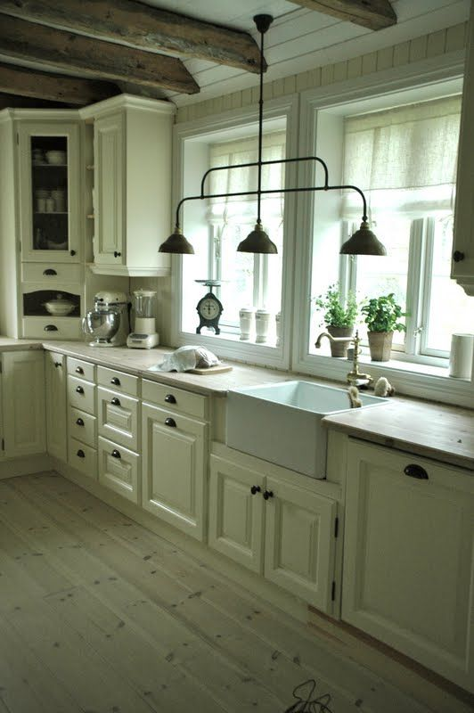 Cream Kitchen Cabinets With Wood Counter