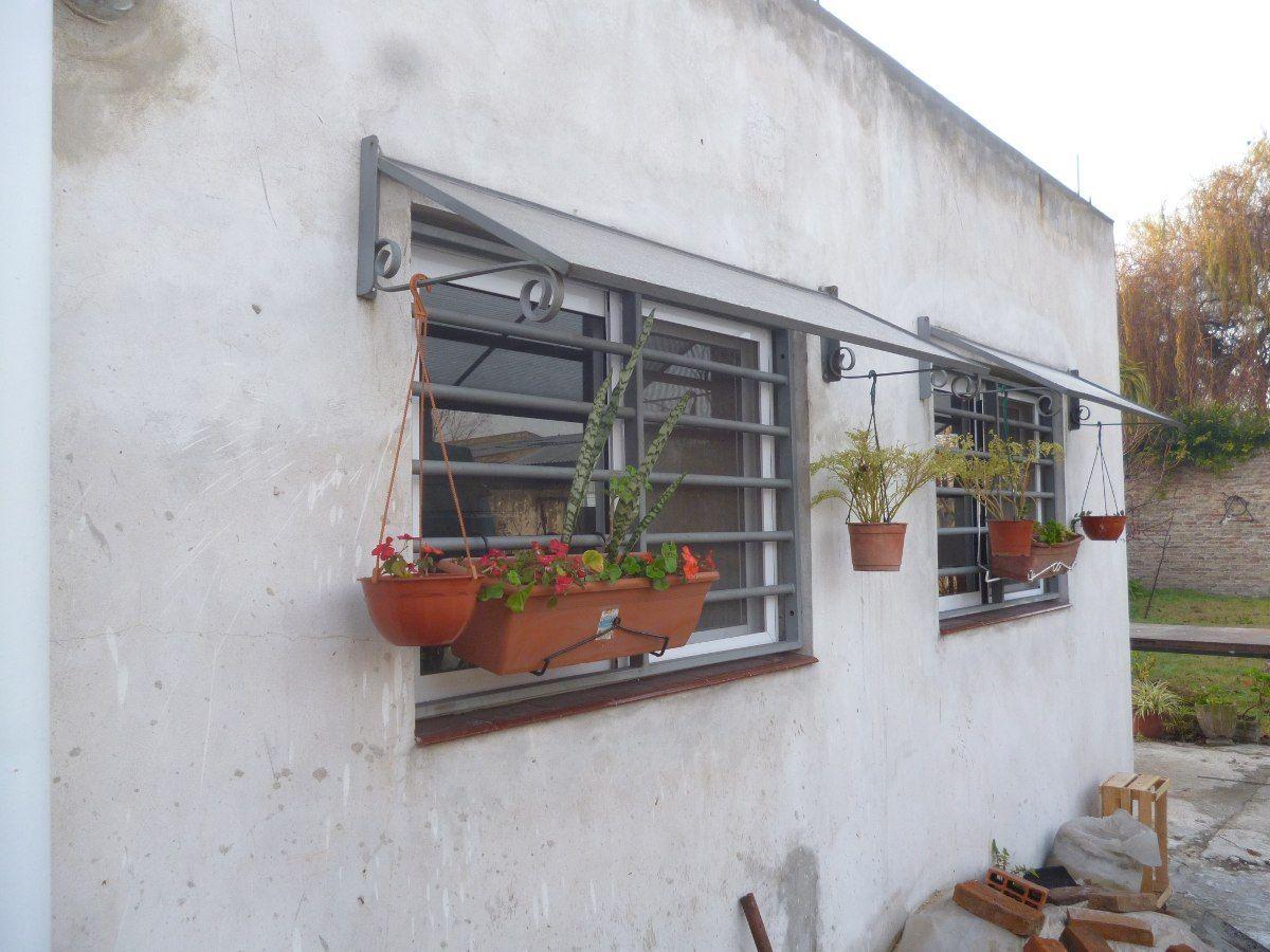 Alero en hiero y policarbonato ventana ventanas for Ventanales tipo puerta