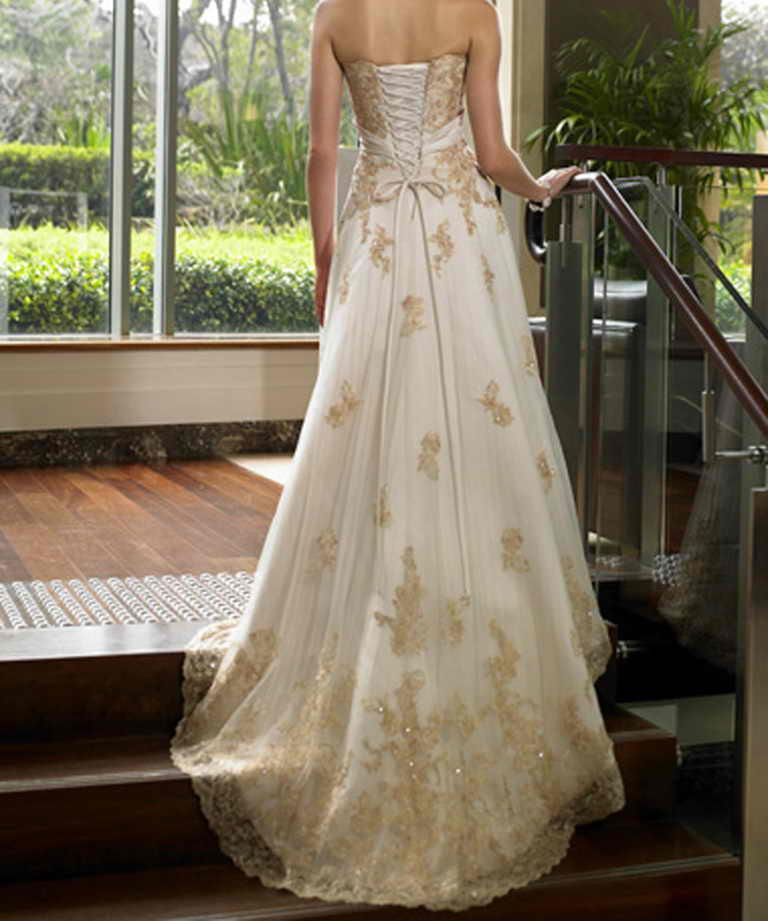Plus size gold and white wedding dress