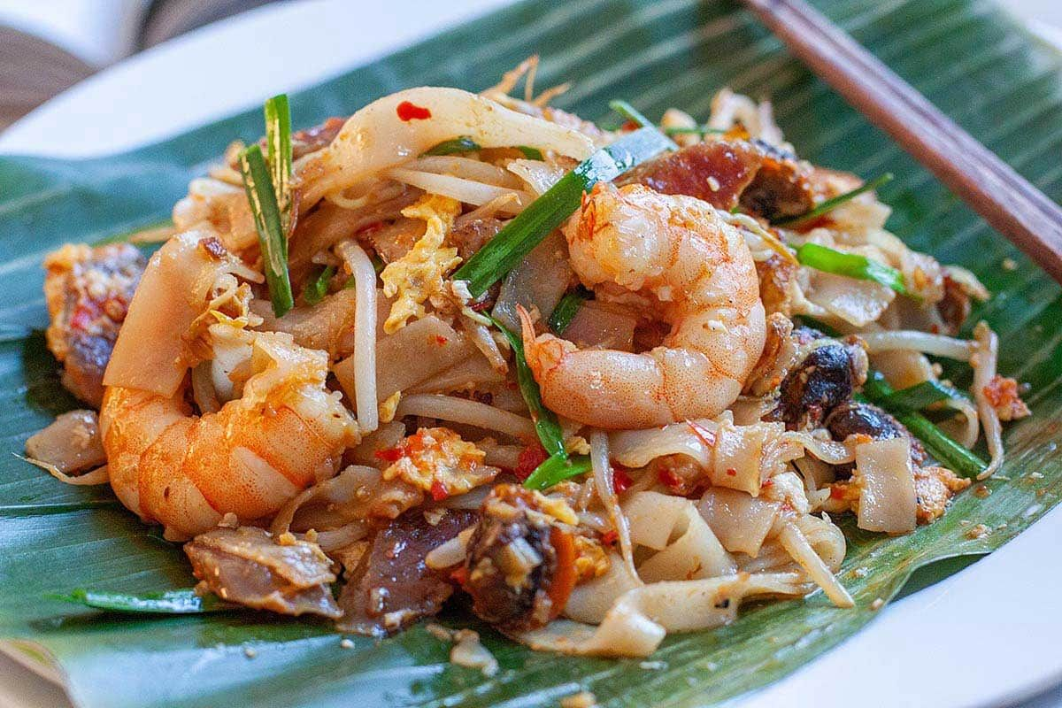 Authentic Penang Char Kuey Teow With Step By Step Recipe Guide Char Kuey Teow Is A Famous Penang Hawker Food Asian Recipes Chinese Chive Recipe Yummy Dinners